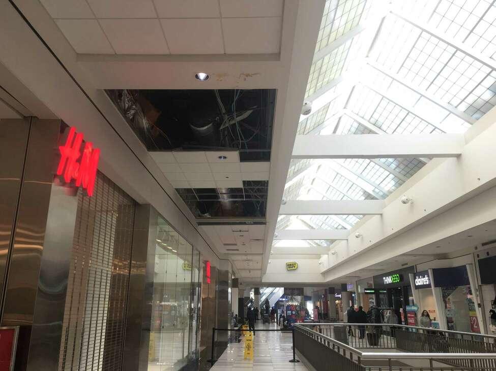 Part of the ceiling outside of the H&M store at Crossgates Mall collapsed Monday from an apparent burst pipe. The store was open as normal Tuesday morning.