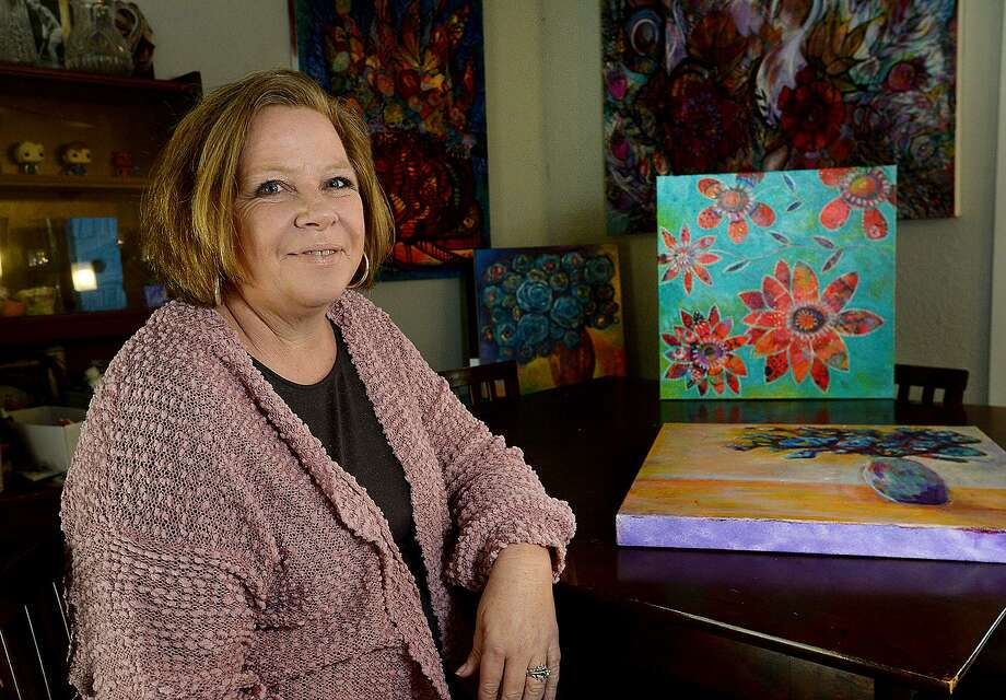 Leanne Blackwell got back into making art 10 years ago and is building a body of paintings filled with bold colors and floral themes. A long-time science teacher, Blackwell now works at Odom Academy after her family moved to Beaumont from Florida last July.  Photo taken Saturday, January 19, 2019 Photo by Kim Brent/The Enterprise Photo: Kim Brent / The Enterprise / BEN
