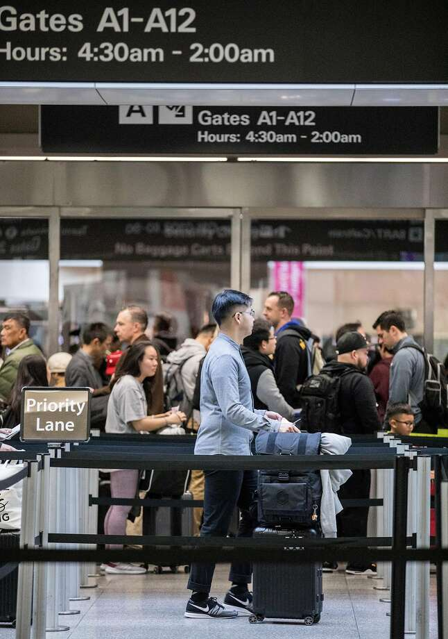 Hundreds of passengers wait to go through a TSA security checkpoint before catching their flights at San Francisco International Airport in San Francisco, Calif. Wednesday, Dec. 19, 2018. Photo: Jessica Christian, The Chronicle