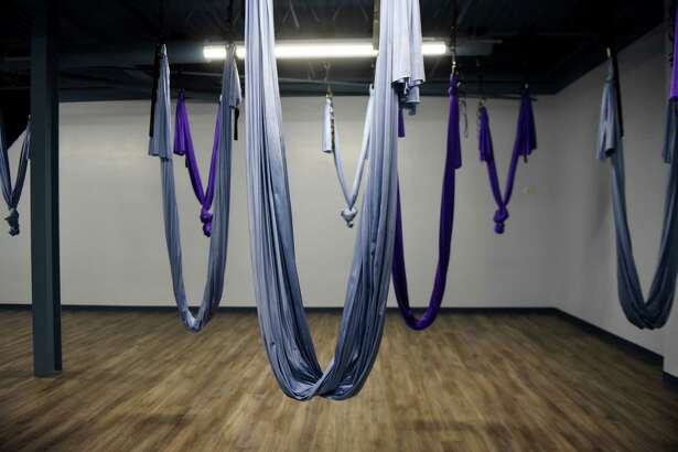 Interior of the aerial yoga studio at The Hot Yoga Spot on Tuesday, Jan. 22, 2019, at Stuyvesant Plaza in Guilderland, N.Y. The business has expanded to include three traditional yoga studios and one aerial studio, a juice and smoothie bar and two float therapy tanks. (Will Waldron/Times Union)