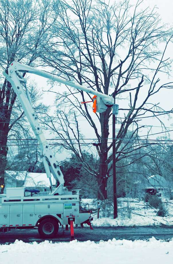 Eversource workers repair utility lines in Middletown in this file photo. Photo: Tina Clemmey Photo