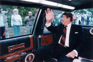 US President Ronald Reagan waves from the back of his limousine to a line of people on the street as he heads toward a campaign stop in Fairfield, Connecticut, 26th October 1984.  (Photo by Ronald Reagan Library/Getty Images)