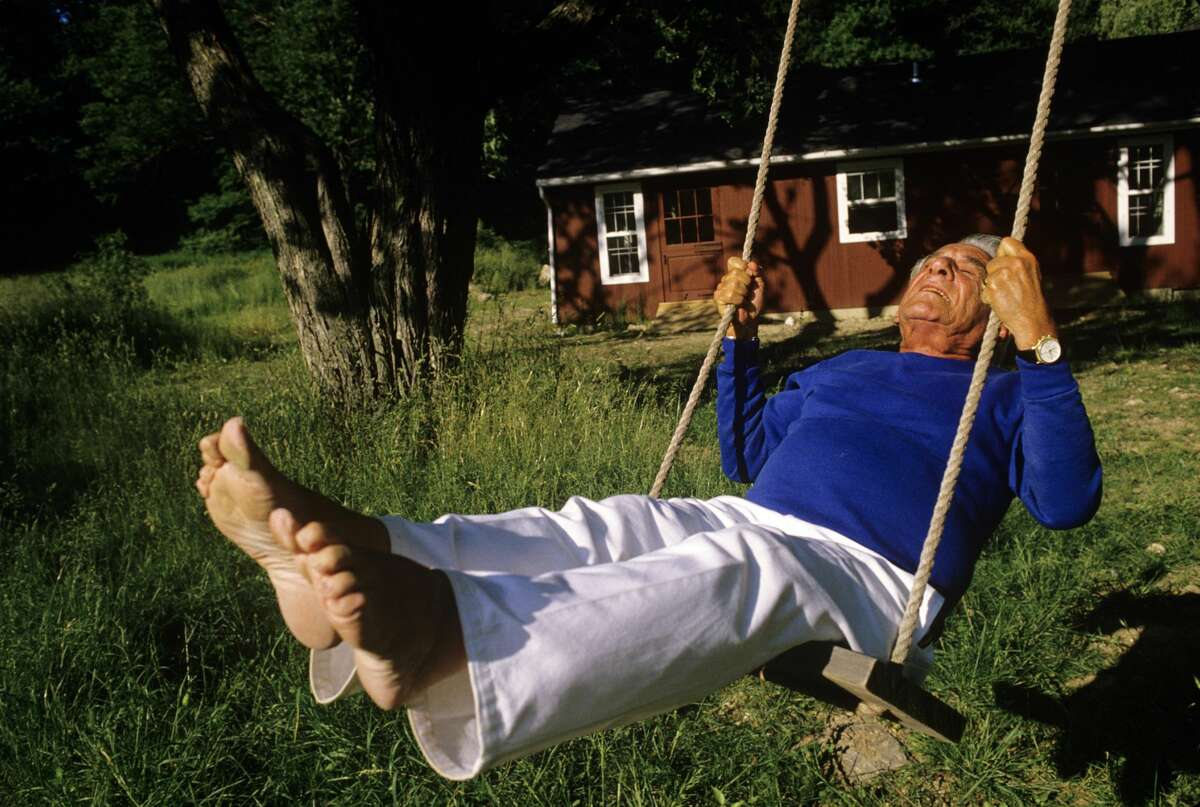 Composer Leonard Bernstein swings on 1986 outside of his Fairfield, Connecticut home. Bernstein's most recognizable affiliation was as the longtime music director of the New York Philharmonic Orchestra. In addition, Bernstein was noted for writing the music for the highly acclaimed musical, West Side Story.
