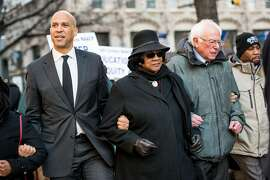 COLUMBIA, SC - JANUARY 21:  U.S. Sen. Bernie Sanders (I-VT), right, president of the South Carolina NAACP chapter, Brenda Murphy, center, and Sen. Cory Booker (D-NJ) march down Main St. to the Statehouse in commemoration of Martin Luther King Jr. Day on January 21, 2019 in Columbia, South Carolina. The South Carolina chapter of the NAACP will mark the occasion with King Day at the Dome. (Photo by Sean Rayford/Getty Images)