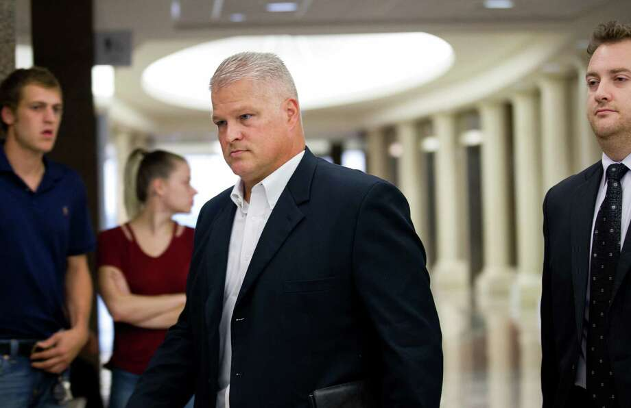 David Temple arrives for a hearing at the 178th District Court Tuesday, Oct. 10, 2017, in Houston. The former Alief Hastings High School football coach spent almost a decade in prison for killing his wife before his conviction was reversed last year. ( Godofredo A. Vasquez / Houston Chronicle ) Photo: Godofredo A. Vasquez, TempleAppears1010 / Godofredo A. Vasquez / Godofredo A. Vasquez / Houston Chronicle