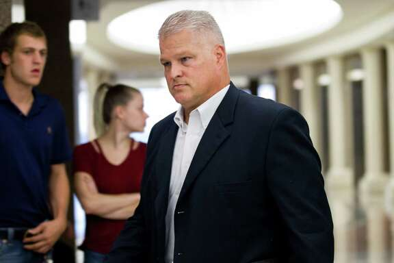 David Temple arrives for a hearing at the 178th District Court on Oct. 10, 2017, in Houston. The former Alief Hastings High School football coach spent almost a decade in prison for killing his wife before his conviction was reversed in 2016. He is now set to go to trial again on July 8, 2019.