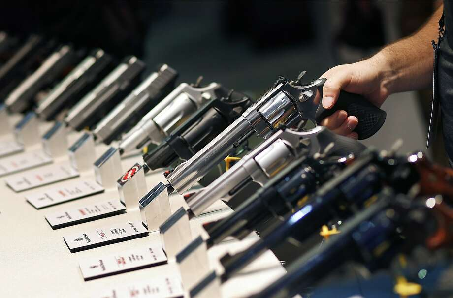 FILE - In this Jan. 19, 2016 file photo, handguns are displayed at the Smith & Wesson booth at the Shooting, Hunting and Outdoor Trade Show in Las Vegas.  Photo: John Locher, Associated Press