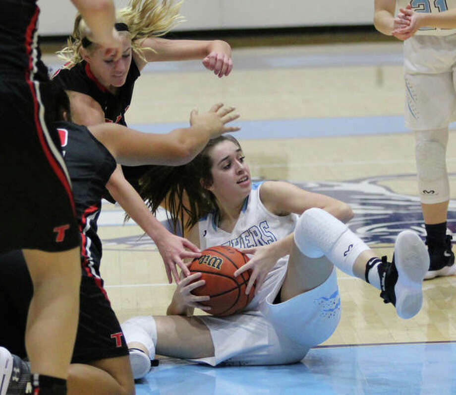 Jersey's Abby Manns, shown looking to pass after retrieving a loose ball in a home game against Triad earlier this season, scored 14 points Monday in the Panthers' victory over Greenfield in the first round of the Carrollton Invitational girls basketball tournament in Carrollton. Photo: Greg Shashack | The Telegraph