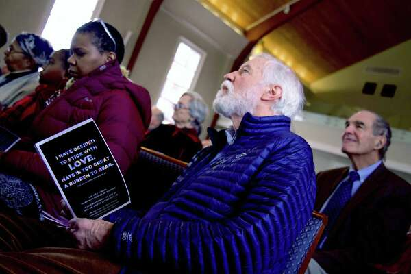 Worshippers were in good spirits at the 17th annual Interfaith Service for Martin Luther King, Jr., at United Methodist Church, Monday, Jan. 21, 2019, in New Canaan, Conn.