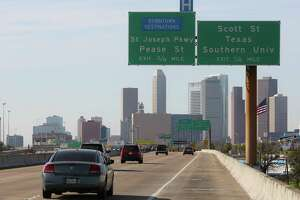 Traffic moves along Spur 5 next to Interstate 45 south of Houston's central business district on March 2, 2017.
