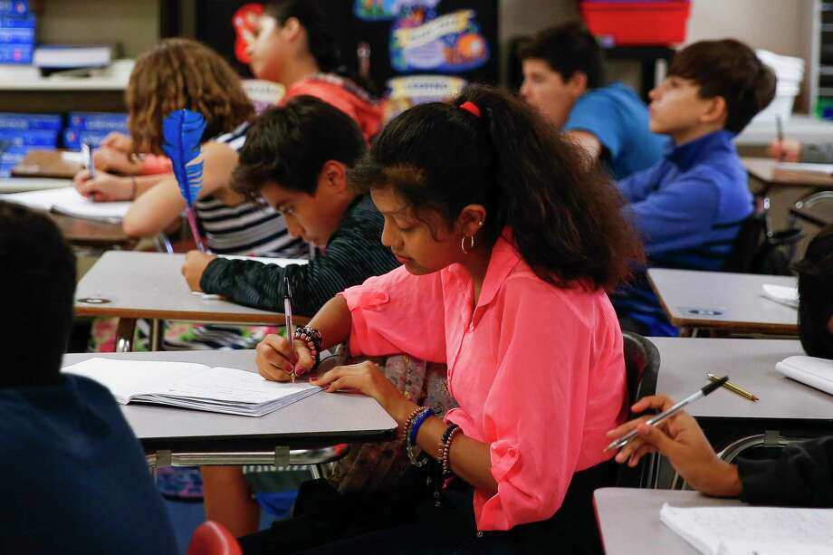 Cleveland Middle School sixth grader Yeshmin Godoy, 11, writes in her notebook during reading class in one of the school's portables Monday Sept. 17, 2018 in Cleveland. Enrollment at Cleveland ISD has nearly doubled since 2014 from 3,800 to 6,500 students, straining the district and schools. Photo: Michael Ciaglo, Houston Chronicle / Staff Photographer / Michael Ciaglo