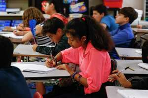 Cleveland Middle School sixth grader Yeshmin Godoy, 11, writes in her notebook during reading class in one of the school's portables Monday Sept. 17, 2018 in Cleveland. Enrollment at Cleveland ISD has nearly doubled since 2014 from 3,800 to 6,500 students, straining the district and schools.
