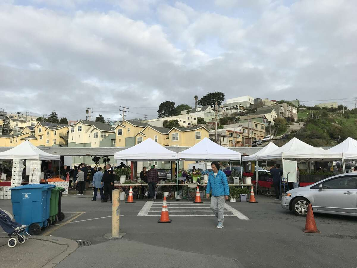 Food items, including citrus, carrots and raisins are sold at the Alemany Farmers Market in San Francisco.