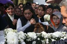 Relatives cry during a funeral of a person who died when a gas pipeline exploded in the village of Tlahuelilpan, Mexico, Sunday Jan. 20, 2019. A massive fireball that engulfed locals scooping up fuel spilling from a pipeline ruptured by thieves in central Mexico killed dozens of people and badly burned dozens more on Jan. 18. (AP Photo/Claudio Cruz)