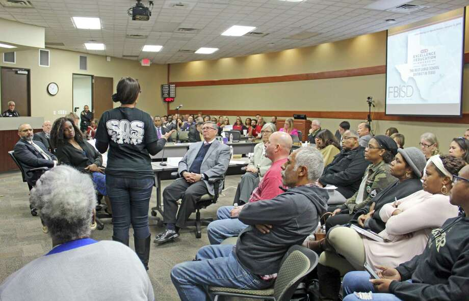 Fort Bend ISD trustees listen as Stephanie Brown, president of the Marshall High School PTO speaks during public comment at the Jan. 14 board meeting.