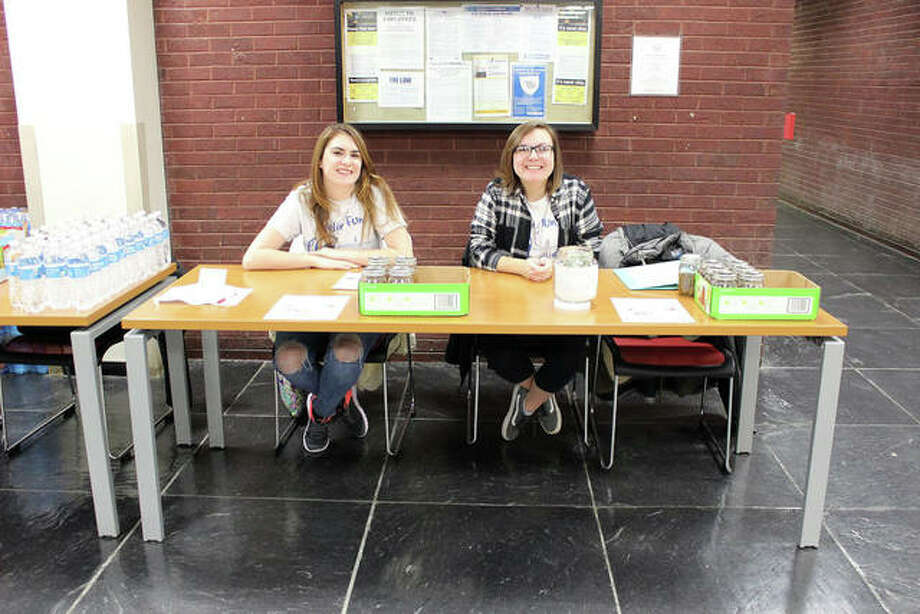 """Accepting donations for homemade pickles are From the Ground Up Co-Presidents Catherine """"Cat"""" Akley, right, and Shea Walker. Photo: For The Intelligencer"""
