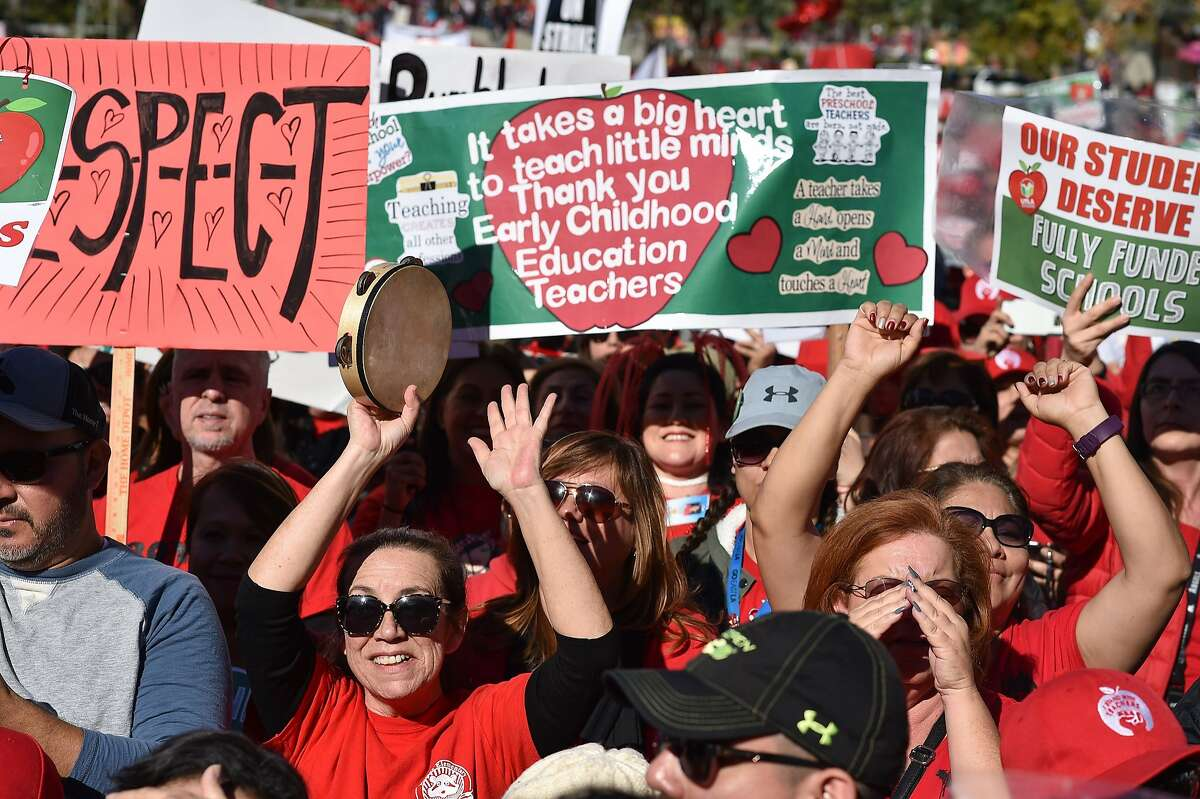 Striking teachers cheer on January 22, 2019, in Los Angeles, as the teacher's union reached a tentative deal with the Los Angeles Unified School District. - Union members have to vote on the agreement to end the strike which started on January 14. (Photo by Robyn Beck / AFP)ROBYN BECK/AFP/Getty Images