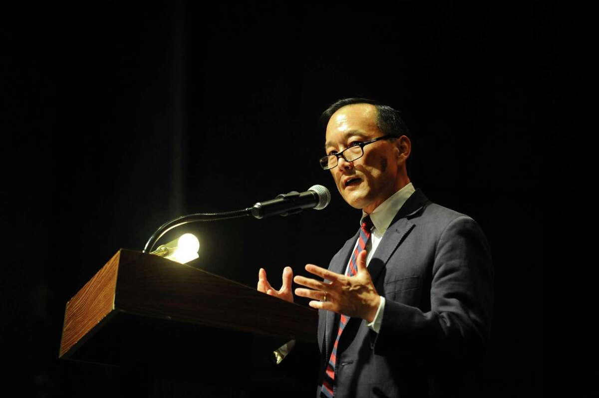 Superintendent Earl Kim speaks during the Academy of Information Technology and Engineering (AITE) graduation inside the Rippowam Middle School auditorium in Stamford, Conn. on Monday, June 19, 2017. Kim has announced he is stepping down as superintendent.