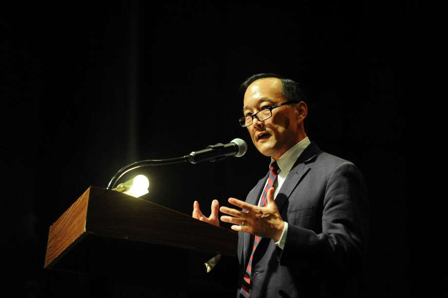 Superintendent Earl Kim speaks during the Academy of Information Technology and Engineering (AITE) graduation inside the Rippowam Middle School auditorium in Stamford, Conn. on Monday, June 19, 2017. Kim has announced he is stepping down as superintendent. Photo: Michael Cummo / Hearst Connecticut Media / Stamford Advocate