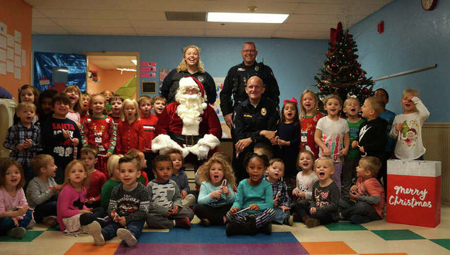One of the more popular activities with area children last year took place when the Glen Carbon Police Association escorted Santa Claus to local daycare center for visits with his most important customers. Photo: For The Intelligencer