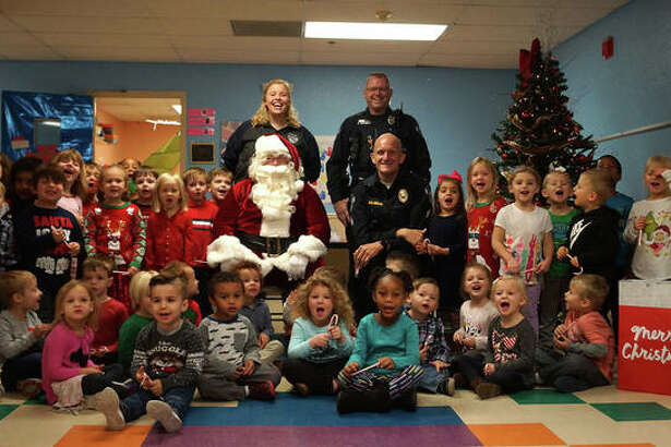 One of the more popular activities with area children last year took place when the Glen Carbon Police Association escorted Santa Claus to local daycare center for visits with his most important customers.