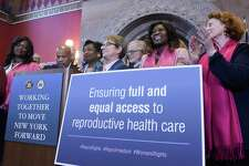 Speaker of the Assembly Carl Heastie, at podium left, and Senate Majority Leader Andrea Stewart-Cousins, at podium right, surrounded by members of the Senate and Assembly, lead a press conference to talk about the impending passage in both chambers of the Reproductive Health Act on Tuesday, Jan. 22, 2019,in Albany,N.Y. (Paul Buckowski/Times Union)