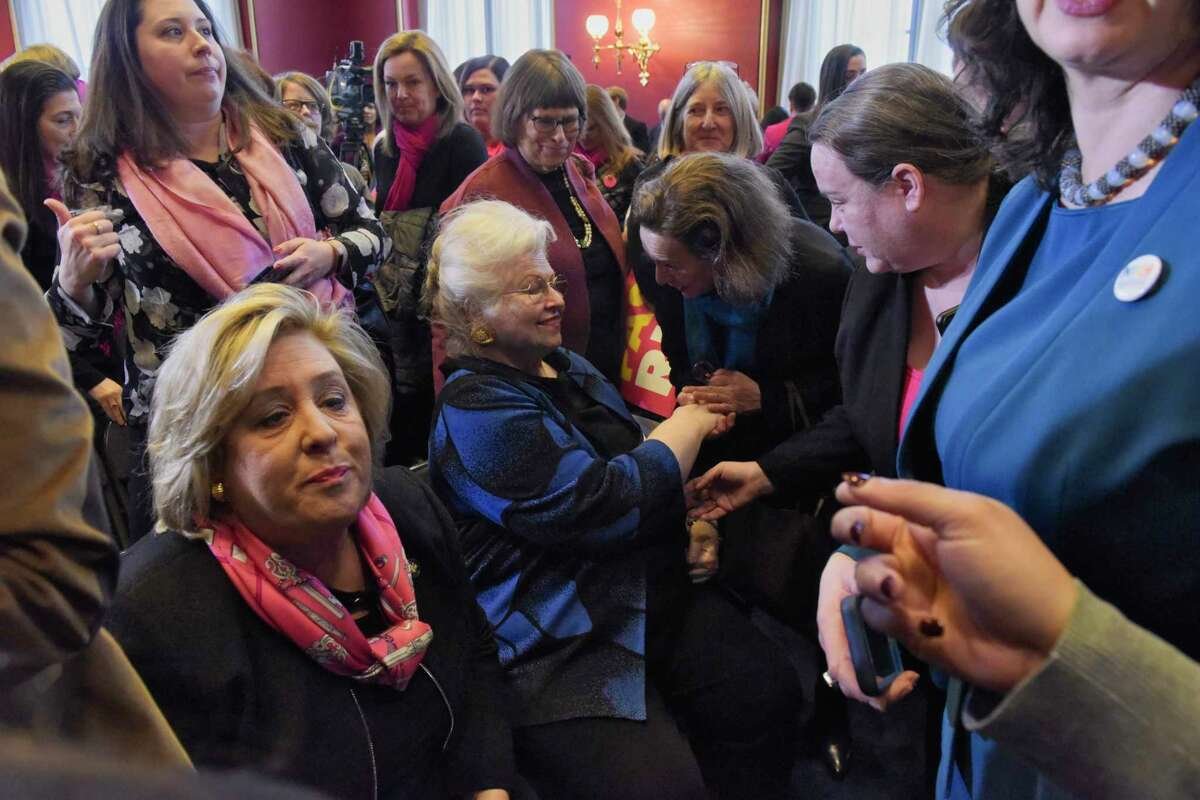 """Women gather around Sarah Weddington, seated, the lawyer who represented """"Jane Roe"""" in the Roe v. Wade case before the United States Supreme Court, following a press conference in the Assembly parlor on Tuesday, Jan. 22, 2019, in Albany, N.Y. (Paul Buckowski/Times Union)"""
