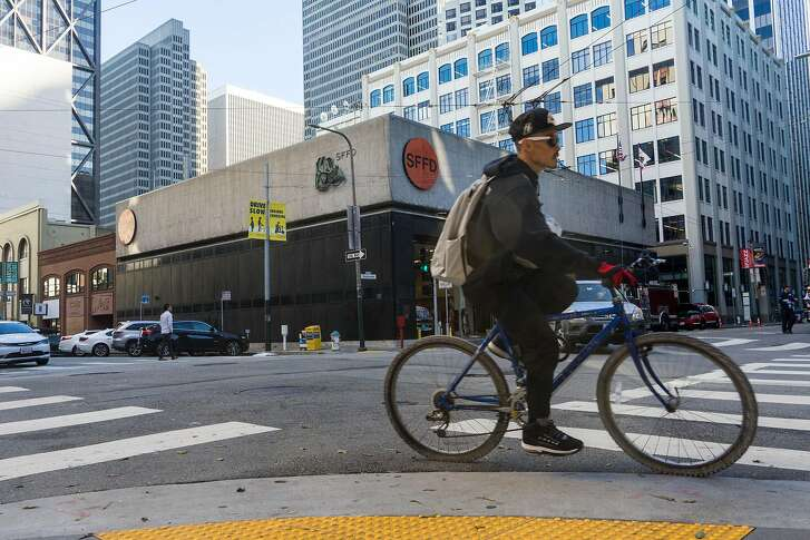 A cyclist passes the fire station at 530 Sansome St. in San Francisco, Calif. on Monday, Jan. 21, 2018. The city is proposing building a fire station and housing at 530 Sansome Street and then use that money from that sale to build affordable housing at 772 Pacific Avenue.