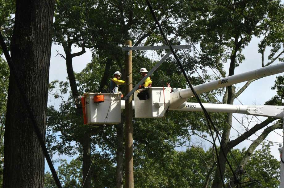Eversource crews repair utility lines in October 2018 in Norwalk, Conn. after storms knocked out power. In April 2019, the Connecticut Public Utilities Regulatory Authority awarded the company authorization to collect $141 million from customers over six years to cover repair costs for five storms in 2017 and 2018. Photo: Alex Von Kleydorff / Hearst Connecticut Media / Norwalk Hour