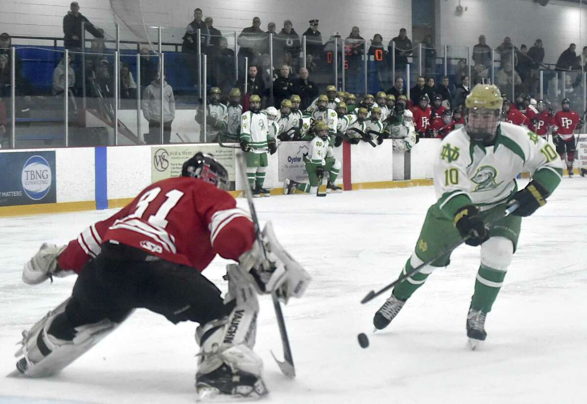 West Haven, Connecticut - Saturday, January 5, 2019: John D'Errico of Notre Dame H.S. of West Haven, right, takes a penalty shot for a score against Jake Walker of Fairfield Prep, left, during second period hockey Saturday at the Bennett Rink in West Haven.