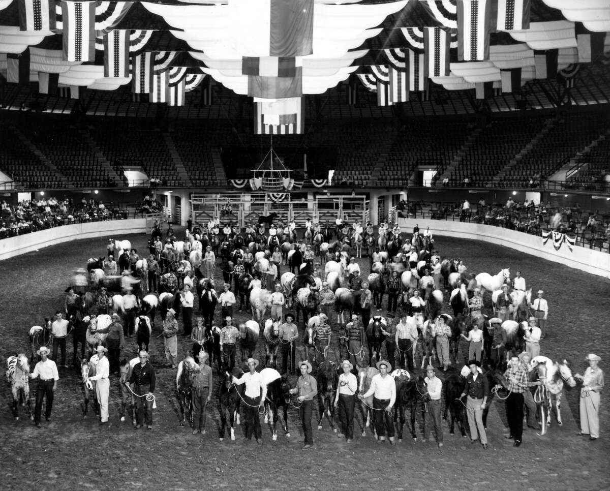 This early group shot taken at the Freeman Coliseum depicts some of the first rodeo contestants in San Antonio, Texas.