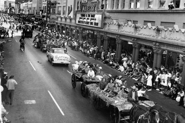 THEN AND NOW FEB. 3 02- The yearly parade procession that opened the San Antonio Stock Show & Rodeo, like this one shown traveling on Houston Street in 1962, was discontinued a few years ago.