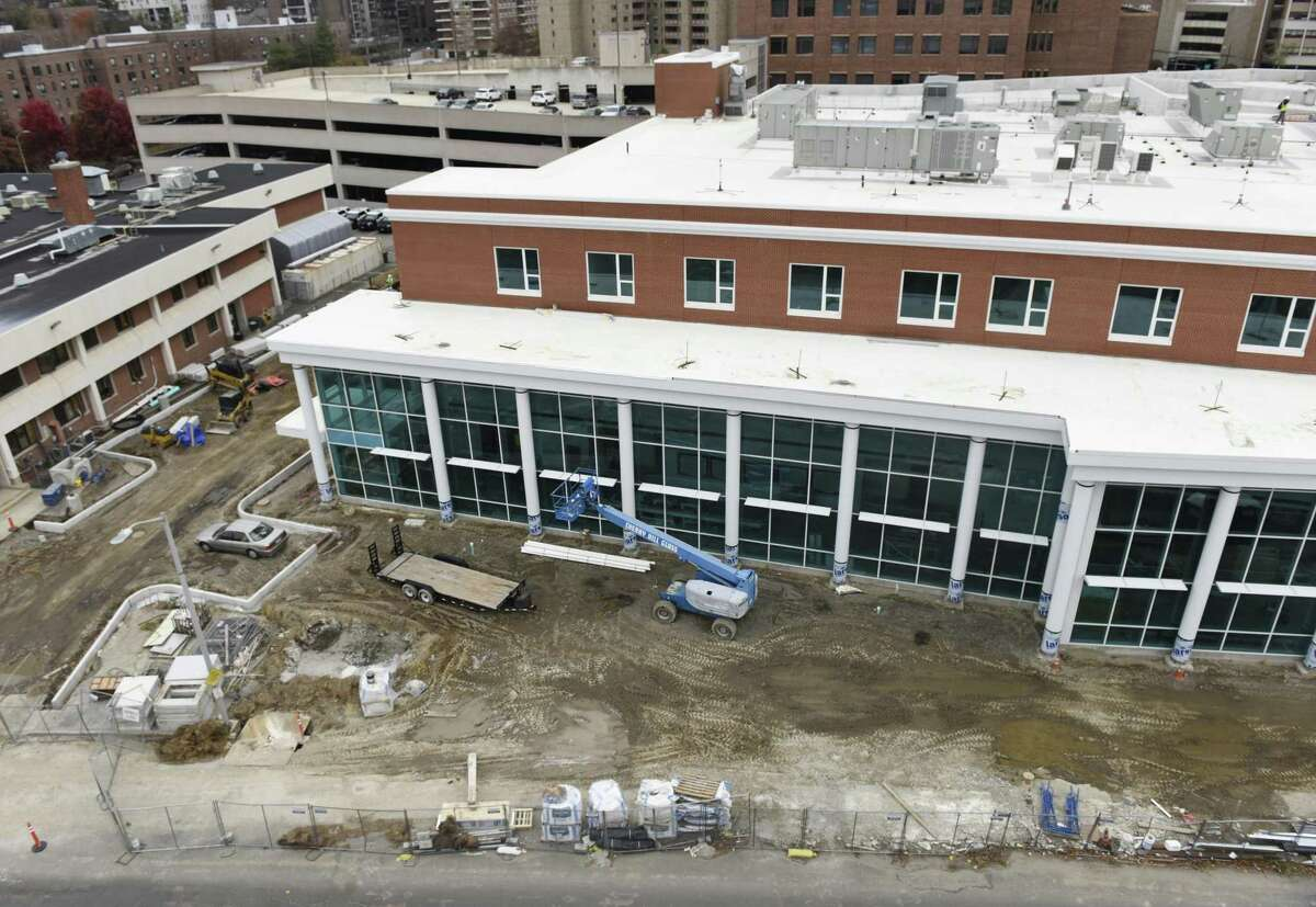 Construction crews continue work on the new police station, right, directly beside the old station, left, in Stamford, Conn. Thursday, Nov. 15, 2018. The new 94,000 sq. ft. station sits on the corner of Bedford Street and North Street, just south of the current police headquarters. The project is still on budget and on track to be completed in late February.
