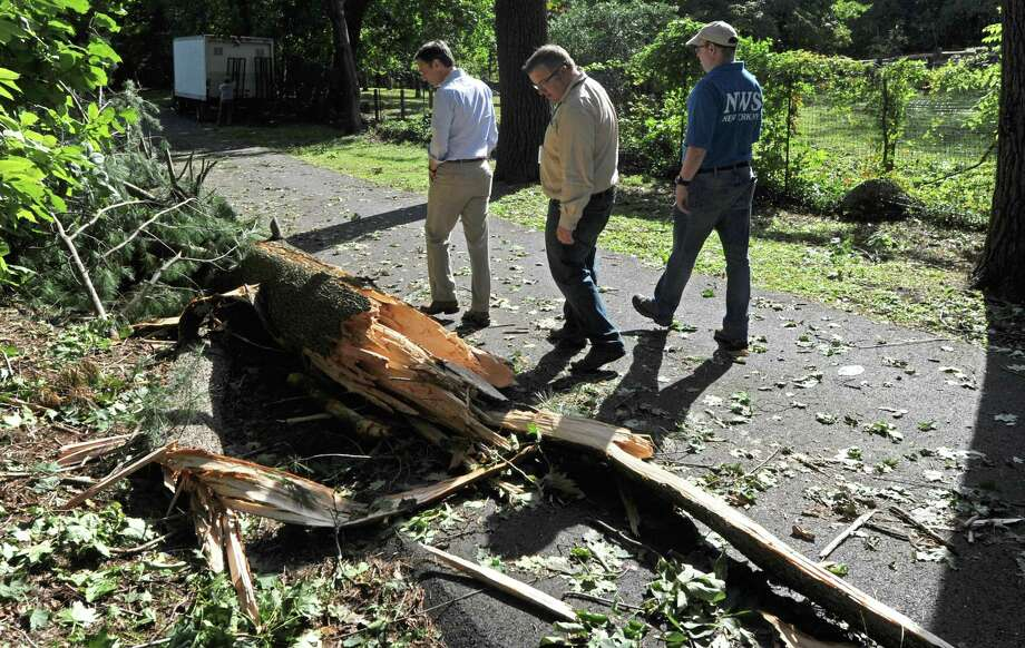 Officials with the National Weather Services and the town of New Canaan inspect damage in the southwestern Connecticut town after a tornado touched down in early October 2018. Photo: Erik Trautmann / Hearst Connecticut Media / Norwalk Hour