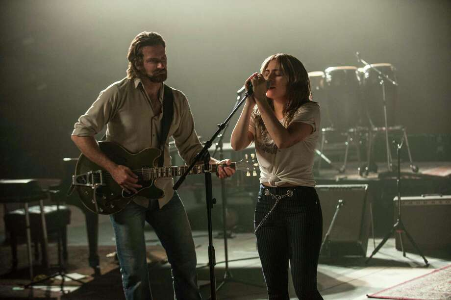 """This image released by Warner Bros. shows Bradley Cooper, left, and Lady Gaga in a scene from the latest reboot of the film, """"A Star is Born."""" (Neal Preston/Warner Bros. via AP) Photo: Neal Preston / © 2017 Warner Bros. Entertainment Inc."""