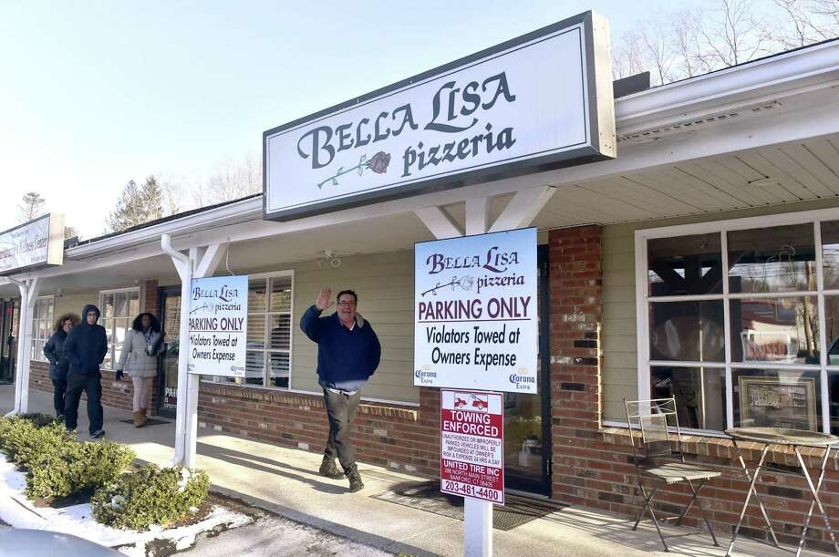 """North Branford, Connecticut - Tuesday, January 22, 2019: Owner Joseph """"Pizza Joe"""" Magistro, right, at his Bella Lisa Pizzeria at the Brookside Plaza at 2429 Foxon Blvd. in North Branford Tuesday afternoon, suffered water damage and a ceiling collapse Photo: Peter Hvizdak / Hearst Connecticut Media / New Haven Register"""