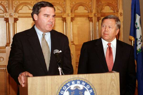 Connecticut Gov. John G. Rowland, left, speaks at a late night news conference at the state Capitol in Hartford, Conn., Tuesday, April 29, 1999, as New England Patriots owner Robert Kraft, right, listens. Kraft and Rowland met for four hours in Rowland's office to discuss the state's plans to build the team a $380 million stadium on the Hartford waterfront prior to the news conference. (AP Photo/Bob Child)