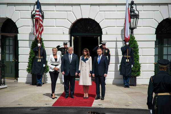 President Donald Trump and first lady Melania Trump greet Polish President Andrzej Duda and first lady Agata Kornhauser-Duda at the White House in September.