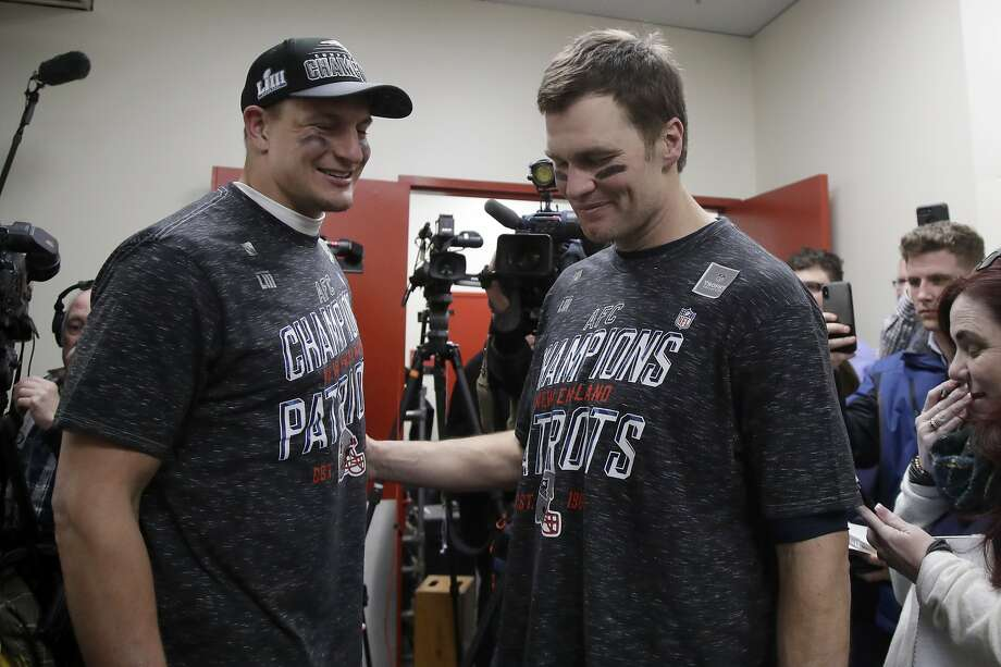 New England Patriots tight end Rob Gronkowski (left, with Tom Brady) contemplated retirement after last year's Super Bowl loss. Photo: Elise Amendola / Associated Press