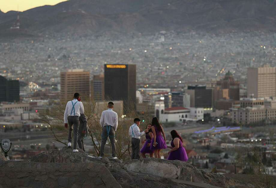 People visit an overview of the skyline of El Paso and Ciudad Juarez, Mexico on Friday in El Paso, Texas. Readers debate immigration and the border. Photo: Joe Raedle /Getty Images / 2019 Getty Images