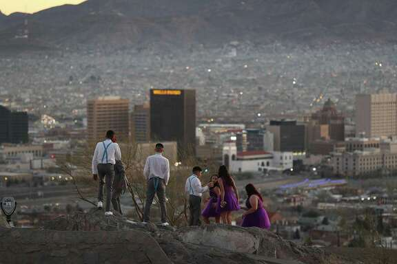 People visit an overview of the skyline of El Paso and Ciudad Juarez, Mexico on Friday in El Paso, Texas. Readers debate immigration and the border.