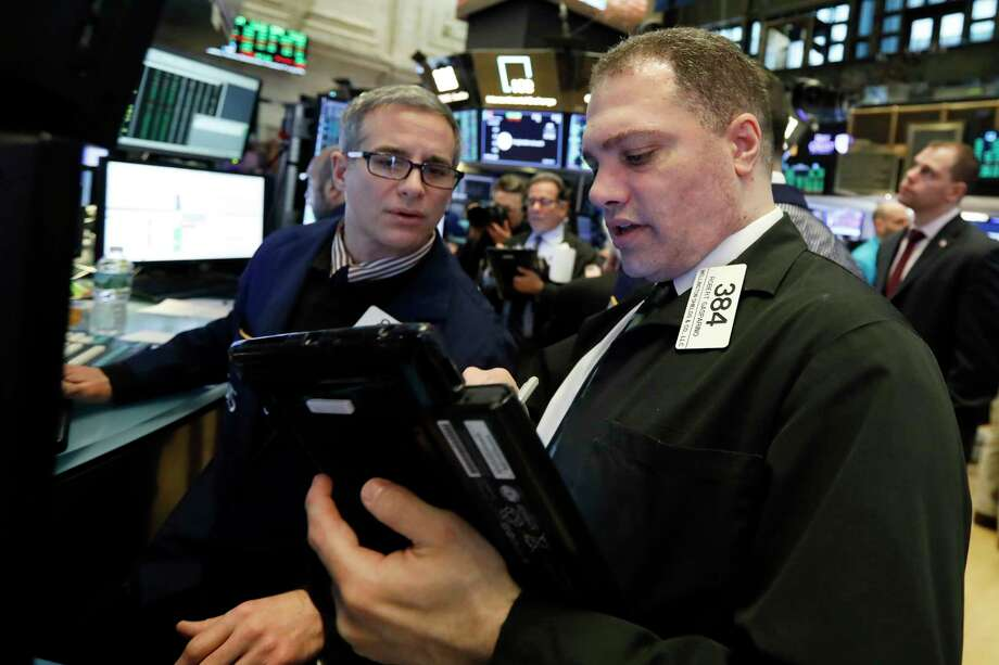 FILE- In this Jan. 18, 2019, file photo specialist Anthony Rinaldi, left, and trader Robert Gasparino work on the floor of the New York Stock Exchange. The U.S. stock market opens at 9:30 a.m. EST on Tuesday, Jan. 22.  (AP Photo/Richard Drew, File) Photo: Richard Drew / Copyright 2018 The Associated Press. All rights reserved.