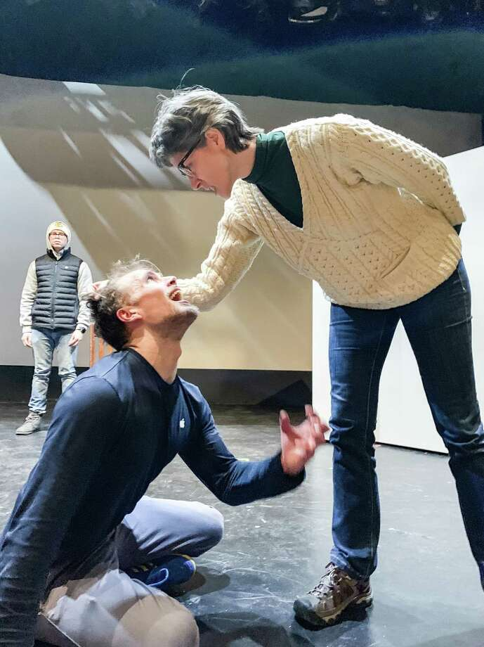 "Chris Kozlowski, as Winston Smith, rehearses with Suzanne Powers, as O'Brien, for George Orwell's ""1984,"" onstage at Bridgeport's Downtown Cabaret Theatre, Feb. 1-17. Photo: Katherine Ray / Contributed Photo"