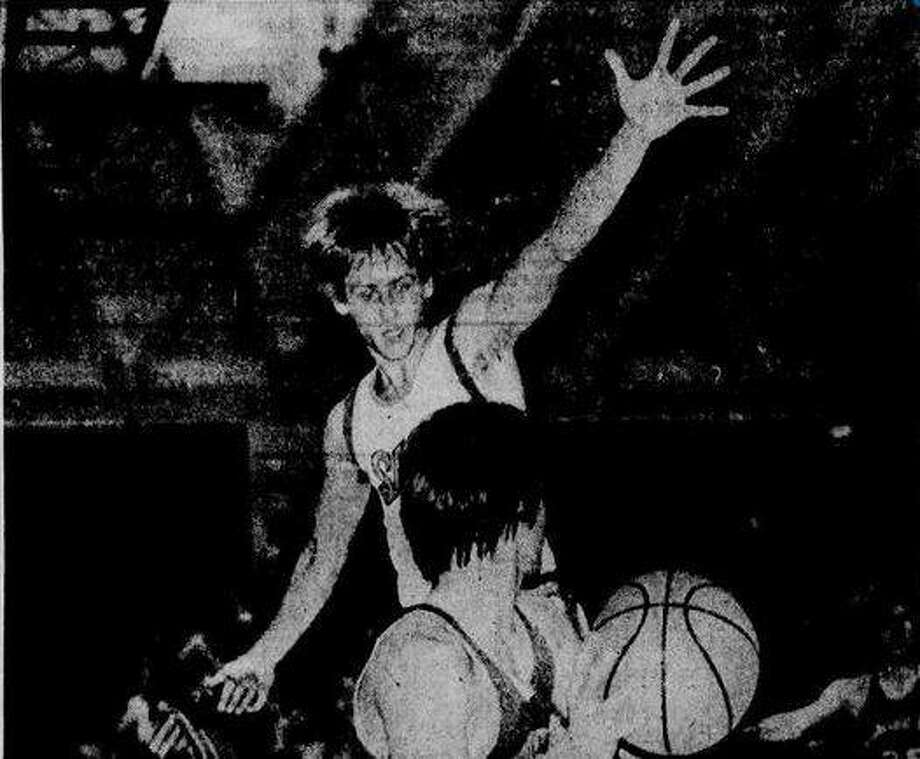 In this Dec. 18, 1978, file photo, Roxana's Roger Brown attempts to block the vision of Marquette Catholic's Chuck Mathews. On Feb. 15, Roxana will recognize the 40th anniversary of the the 1978-'79 team, which won the Mississippi Valley Conference championship.