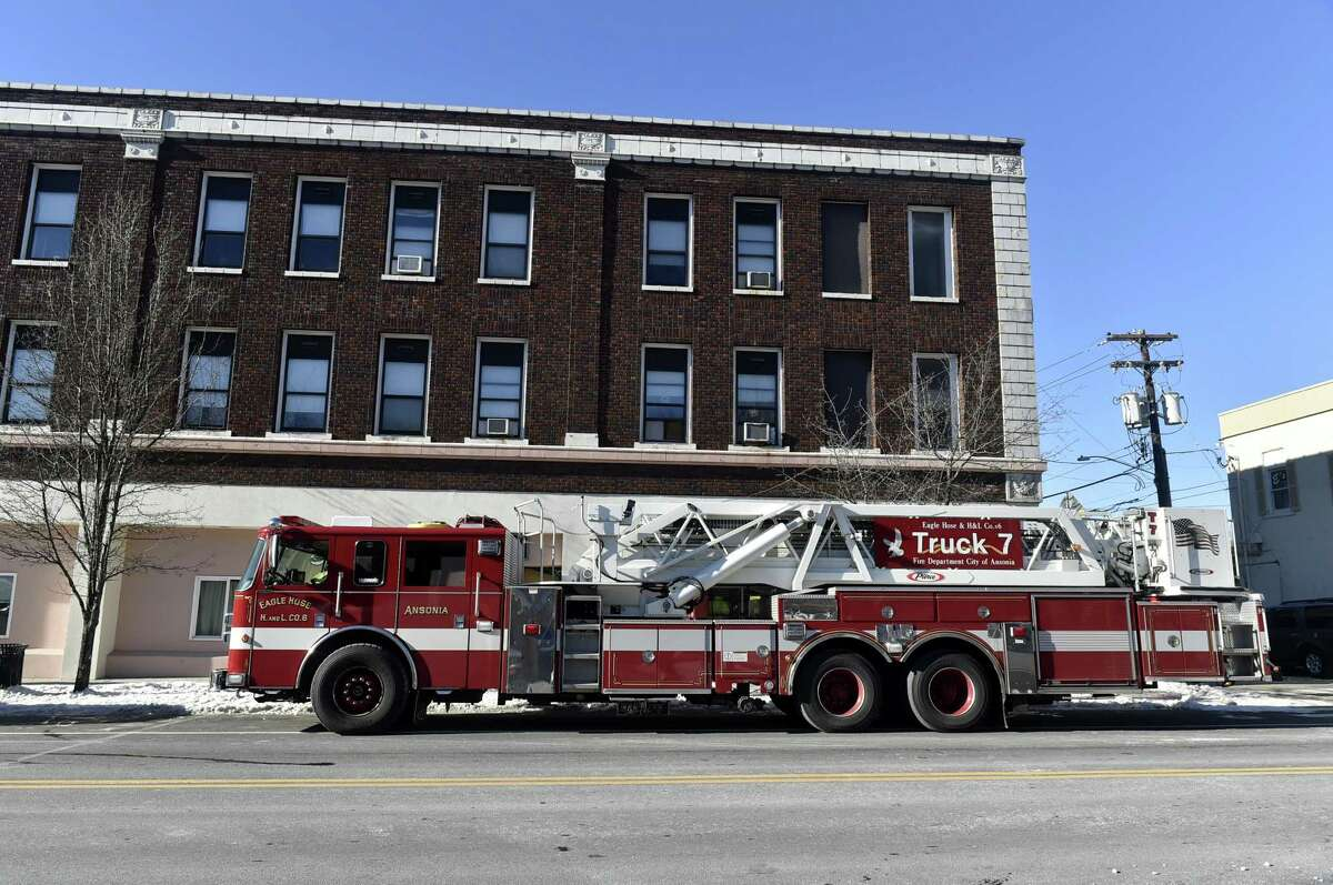 Ansonia, Connecticut - Tuesday, January 22, 2019: An Ansonia firetruck at the apartment building at 290 Main Street in Ansonia after approximately 20 people were temporarily relocated from the building Tuesday morning to the Joseph A. Doyle Senior Center in Ansonia after the building was declared unsafe for occupancy by the city because of burst water pipes.