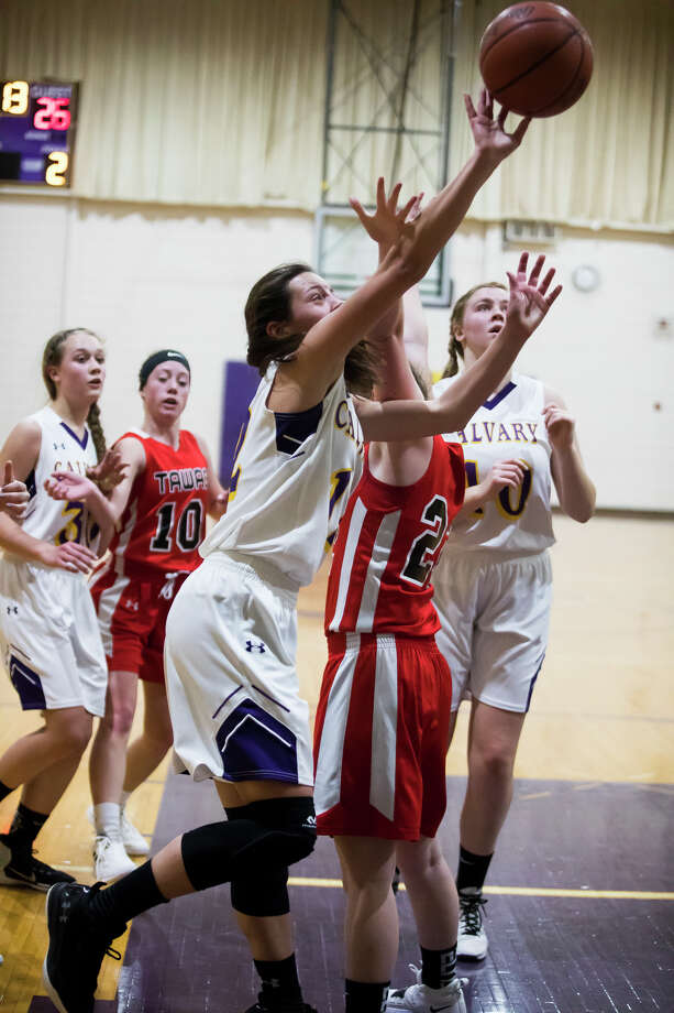 Calvary Baptist's Caroline Holdeman takes a shot during a game against Tawas on Tuesday, Jan. 22, 2019 at Calvary Baptist Academy. (Katy Kildee/kkildee@mdn.net) Photo: (Katy Kildee/kkildee@mdn.net)