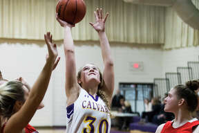 Calvary Baptist's Elaiyna Schwartzkopf takes a shot during a game against Tawas on Tuesday, Jan. 22, 2019 at Calvary Baptist Academy. (Katy Kildee/kkildee@mdn.net)