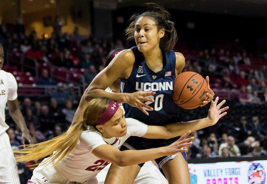 UConn's Olivia Nelson-Ododa, right, keeps the ball away from Temple's Mia Davis, left, during the first half of an NCAA college basketball game Saturday, Jan. 19, 2019, in Philadelphia. Photo: Chris Szagola / Associated Press / Copyright 2019 The Associated Press. All rights reserved.