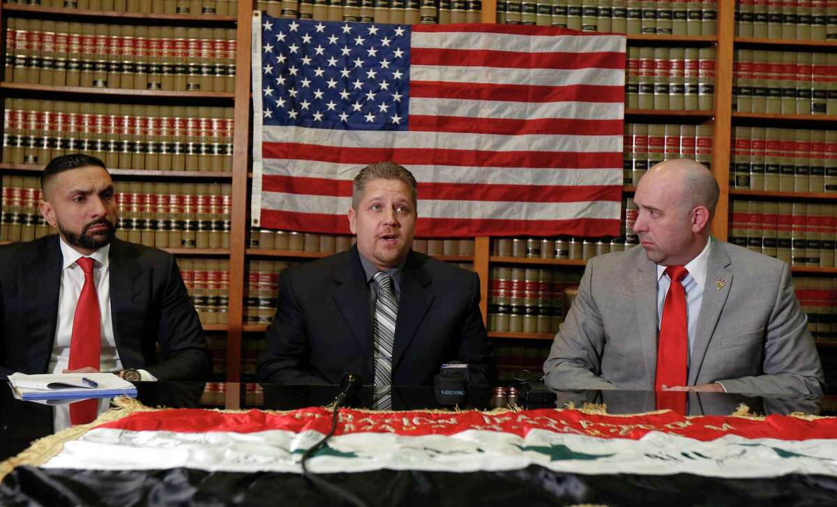 Houston attorneys Mo Aziz (left) and Andrew Cobos (right) represent Sergeant Scott D. Rowe (center), a United States Army veteran, in a lawsuit against 3M Company Tuesday, Jan. 22, 2019, in Houston. The lawsuit focuses on 3M Company, manufacturer of the dual-ended Combat Arms™ earplugs issued to veterans who served in the U.S. military between 2002 and 2013. The lawsuit alleges that 3M Company designed and manufactured the earplugs in a defective manner and failed to warn users of these defects or to provide proper instructions for their use, which has resulted in hearing loss, tinnitus (ringing or buzzing in the ears), and loss of balance in those who used 3M's dual-ended Combat Arms™ earplugs during their military service.