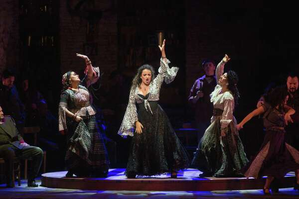 """The Warner Theatre's Met in HD series from the Metropolitan Opera continues with Bizet's """"Carmen"""" Feb. 2.Danielle Talamantes as Frasquita, Clémentine Margaine in the title role, and Shirin Eskandani as Mercédès in Bizet's Carmen. Photo by"""